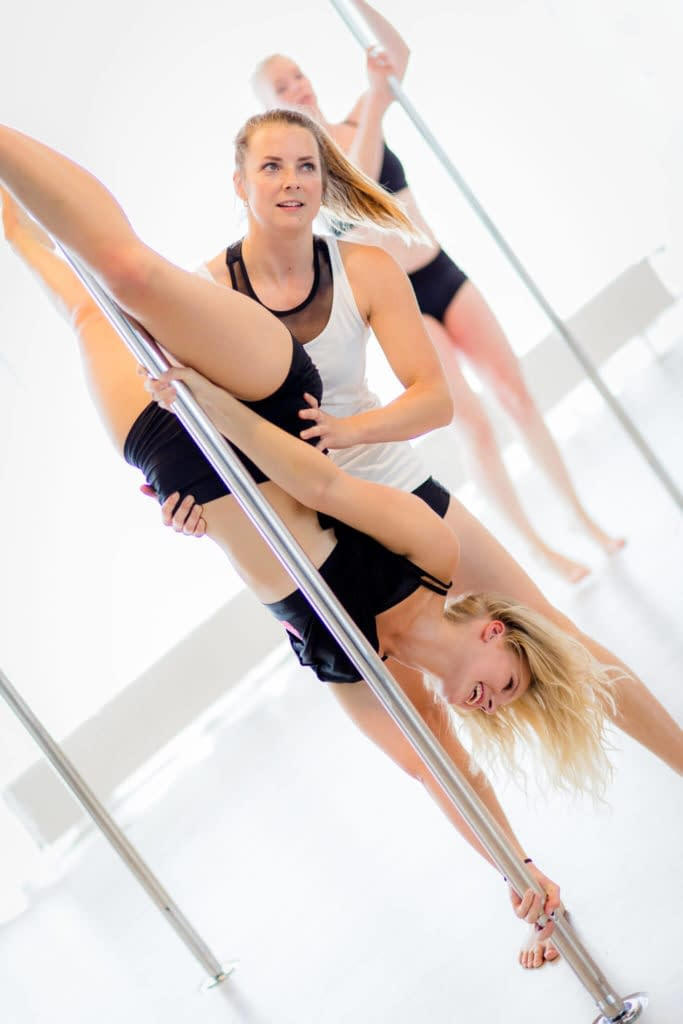 pole fitness girl supported