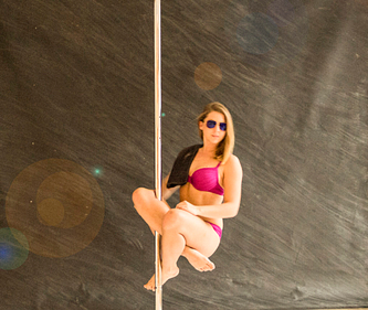 girl sitting in a pole with sunglasses
