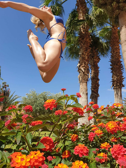 girl jumping up in the sky